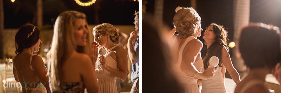 bride dancing wit a bridesmaid at the reception