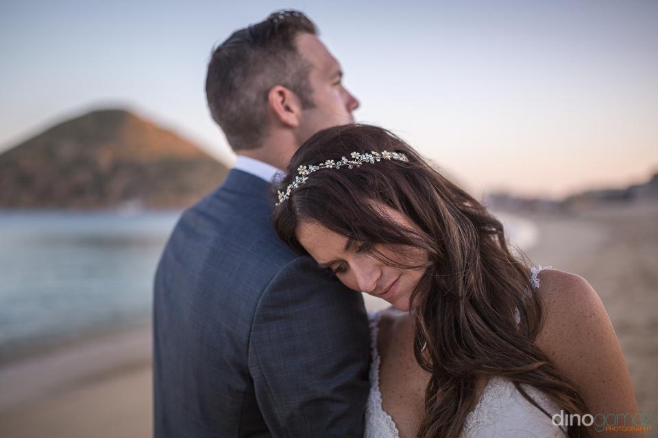 bride leaning on the brooms shoulder - Monica & Parker Wedding b