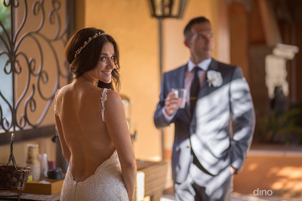 bride showing off her open back dress - Monica & Parker Wedding