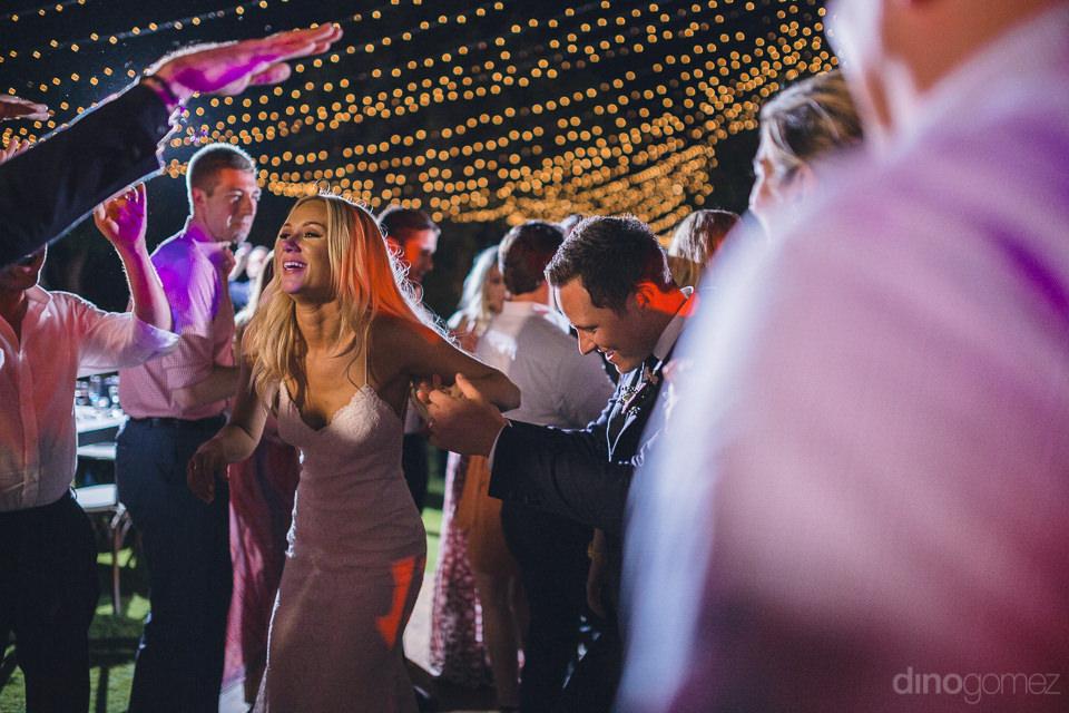 partying at flora farms wedding reception