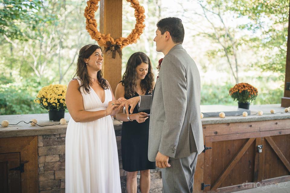 bride puts ring on grooms finger in fairytale wedding in new yor