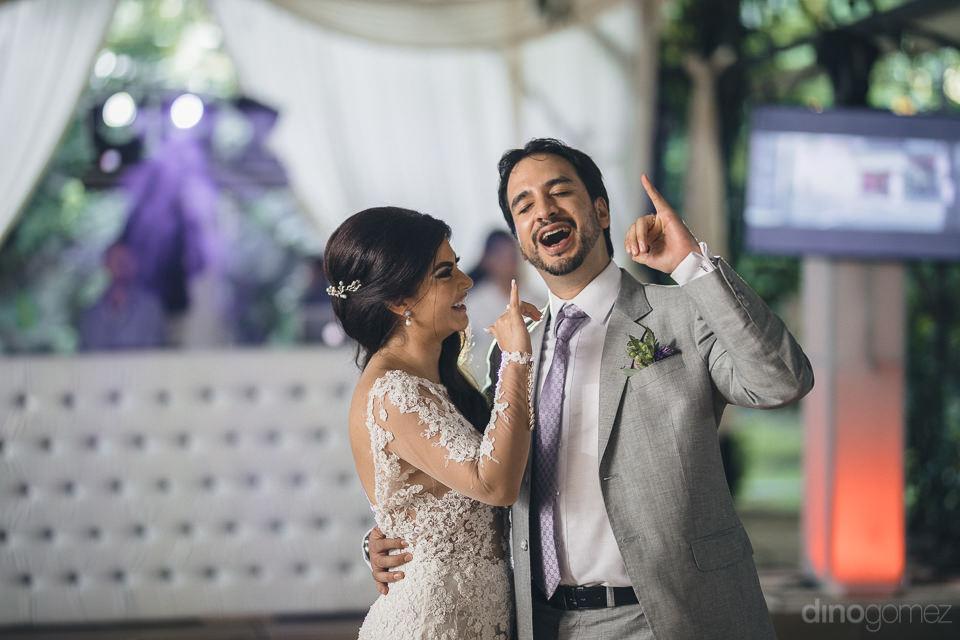 newlyweds pose in fun photo for hacienda wedding photographer di