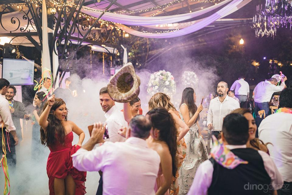 hacienda casasano wedding reception guests on dance floor