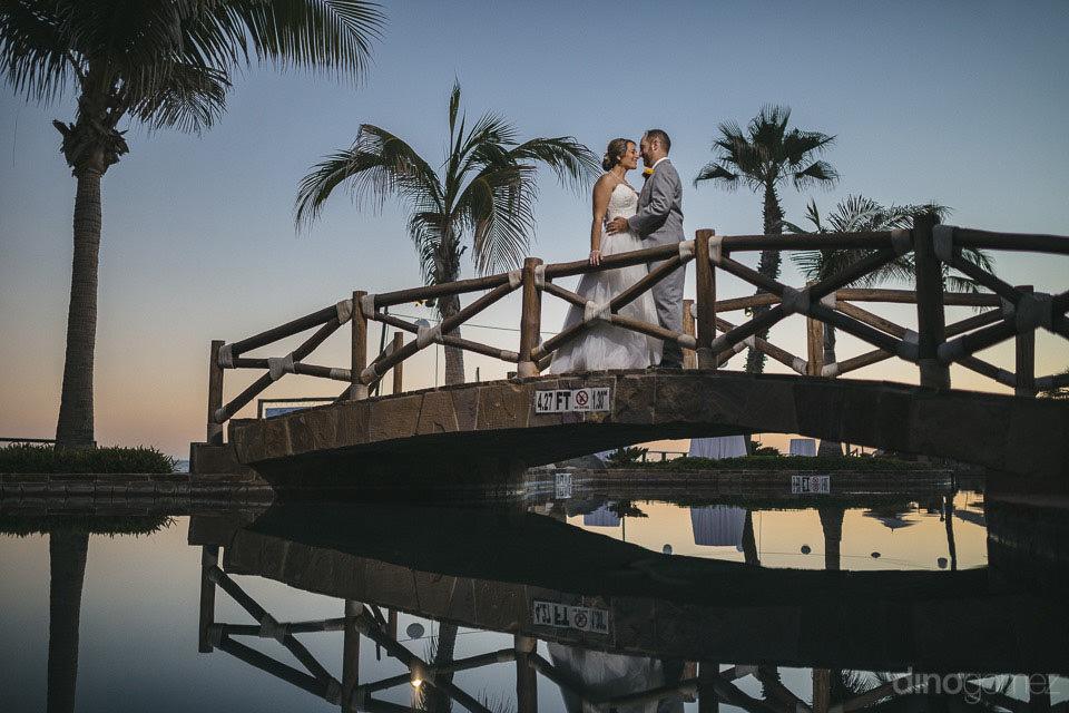 Bride & Groom standing on a bridge kissing - Jo & KC's Wedding in Cabo