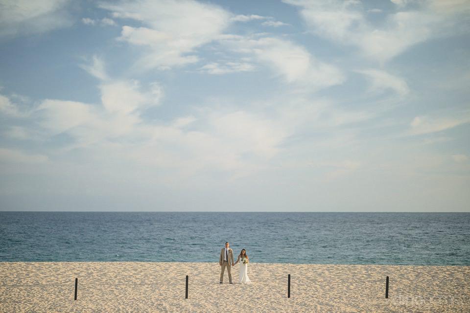 wide shot of the newlyweds on the beach - Chiara & Jeremee